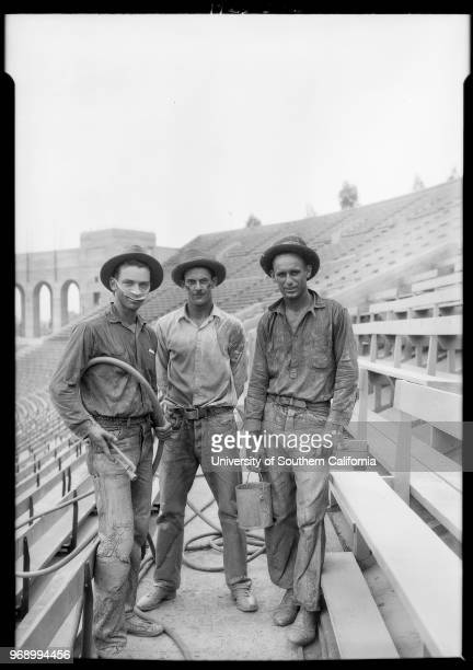 Photograph of 3 USC trackmen at work in coliseum 3911 South Figueroa Street Los Angeles California 1925