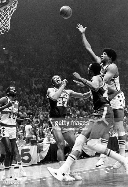 A photograph of a basketball match of the Washington Bullets vs Seattle SuperSonics with Bob Dandridge John Johnson Wes Unseld and Marvin Webster...