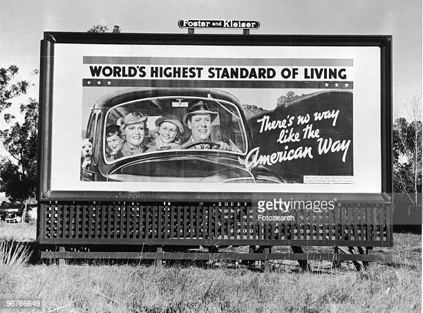 A Photograph of a Billboard from Foster and Kleiser with the Slogan 'World's Highest Standard of Living There's No Way Like the American Way' in...