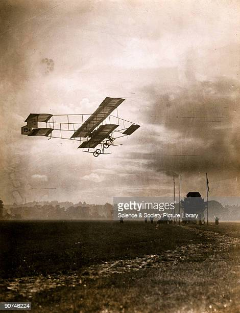 Photograph of a biplane flying at dusk taken on the final day of the Wolverhampton Flying Meeting organised by the Midland Aero Club and held at...