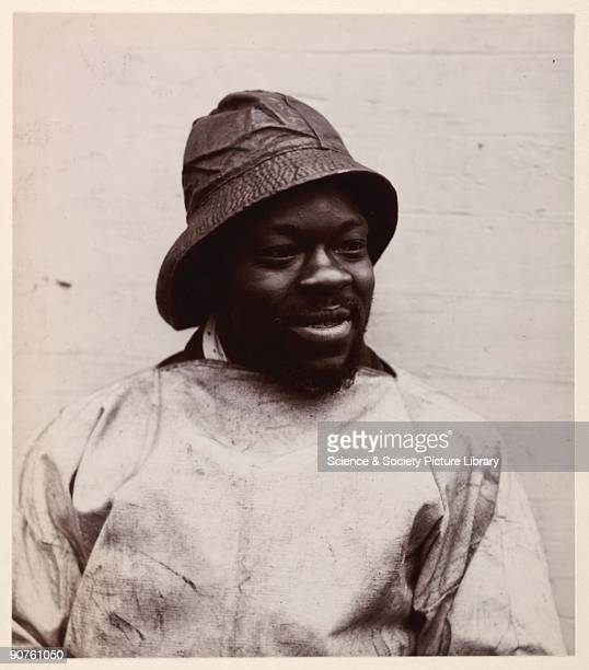 A photograph of a black fisherman taken by George Davison [18541930] in about 1900 probably in Lowestoft This head and shoulders portrait shows the...