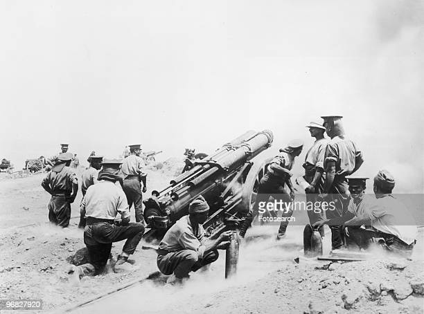A Photograph of a British 60 pounder Mk battery in action on a Cliff top at Cape Helles Gallipoli in June 1915