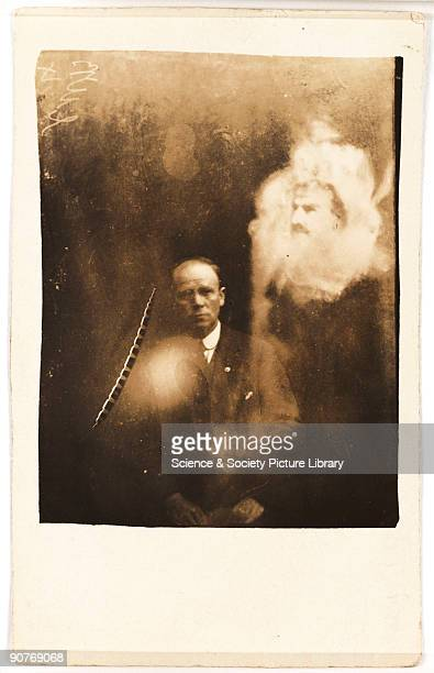 A photograph of a clergyman taken by William Hope The clergyman and his wife had attended a seance at which a voice was heard claiming to be their...