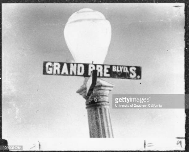 Photograph of a closeup of Grand Pre Boulevard South street sign and street light 'A Los Angeles street by any other name might not be so hard to...
