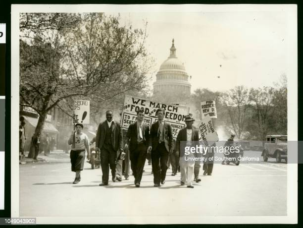 Photograph of a Communist parade in Washington DC Banners include 'We march for food and freedomto free the Scottsboro boys[] hunger []' 'Fight...