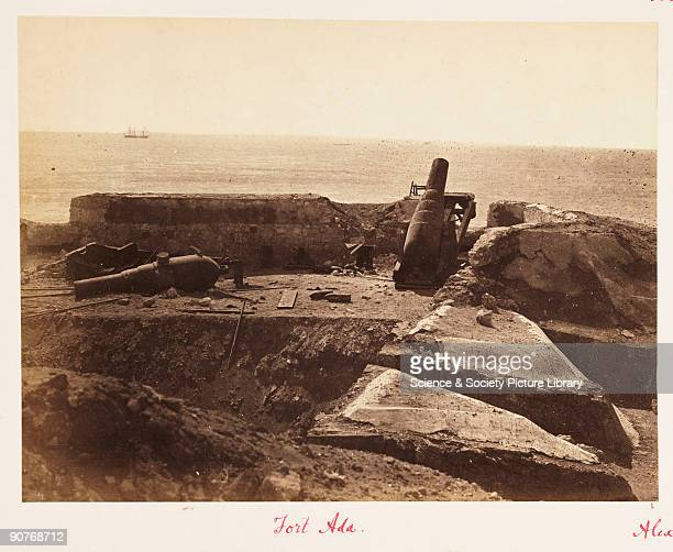 Photograph of a damaged gun battery on the walls of Fort Adda in Alexandria Egypt from an album entitled 'Algiers Egypt c 18821883' Fort Adda was one...