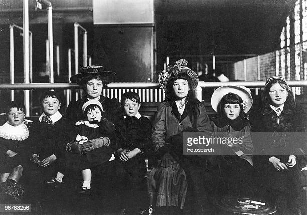 A Photograph of a Family of Immigrants Seated on a Bench on Ellis Island New York circa 1880