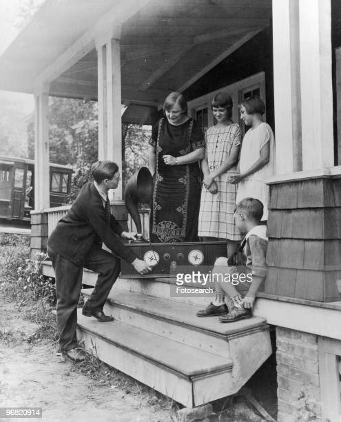 Photograph of a Family on a Porch Listening to a Radiola circa 1920
