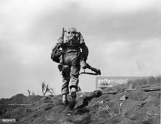 A Photograph of a Fifth Division Marine in Full Battle Gear Under Enemy Fire on Iwo Jima February 19th 1945