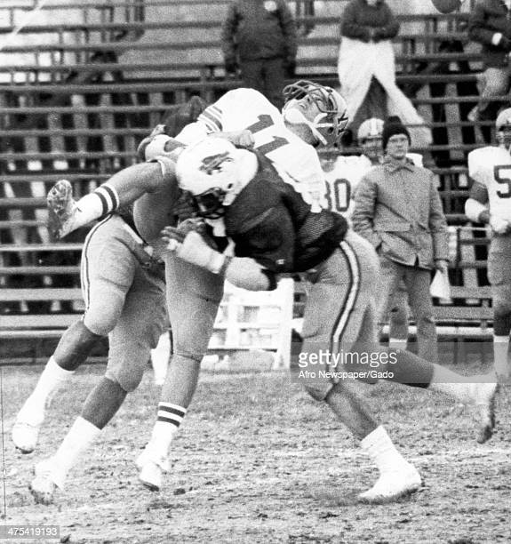 Photograph of a football tackler during a North Dakota Bison football game, 1980.