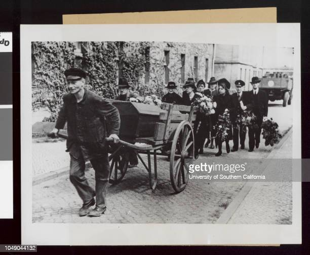 Photograph of a funeral ceremony in Berlin Germany 'FC1025620 Watch your credit International News Photos | Slug | Unburied dead is the newest Berlin...