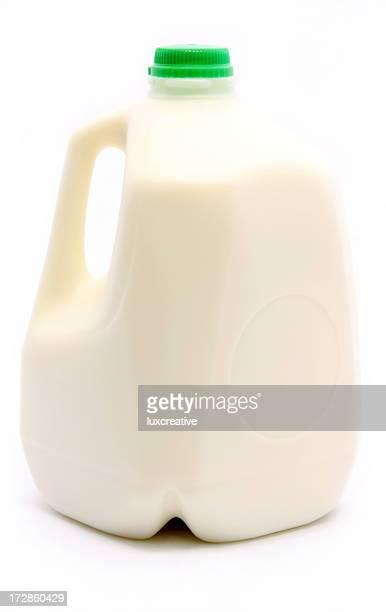 Photograph of a gallon of milk with a green cap
