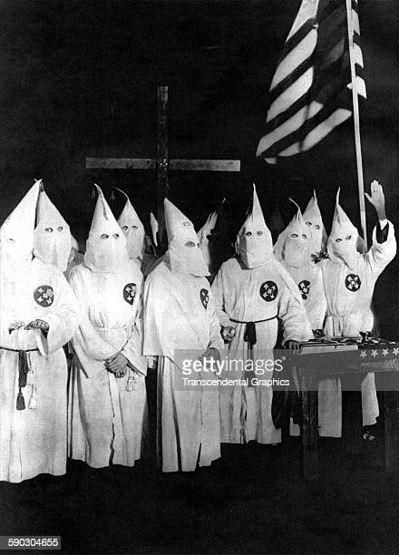 Photograph of a group of Ku Klux Klansmen at a demonstration with hooded costumes shot, Baltimore, Maryland, 1923.