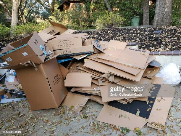 Photograph of a heap of compressed cardboard moving boxes following a domestic house move in Lafayette, California, December 3, 2020.