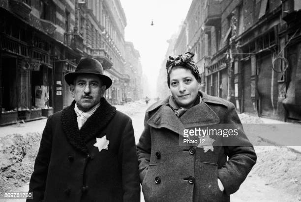 Photograph of a Jewish couple in the Warsaw Ghetto. Dated 1942.