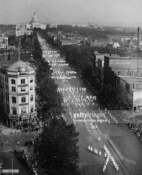 Photograph of a Ku Klux Klan parade on Pennsylvania Avenue Washington DC with the US Capitol Building in the background Dated 1926 Photo by