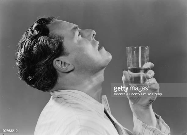 A photograph of a man gargling with a glass of water taken by Photographic Advertising Limited in 1951 Photographic Advertising Limited founded in...