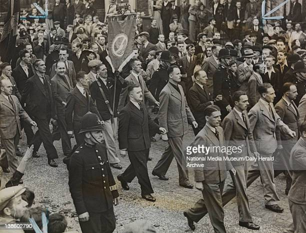 A photograph of a march by the British Union of Fascists in July 1937 In January 1937 the Public Order Act had banned political uniforms so there are...