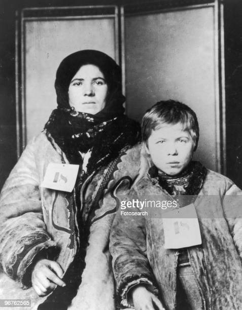 A Photograph of a Mother and Son with Tags numbered '18' on Ellis Island New York circa 1880