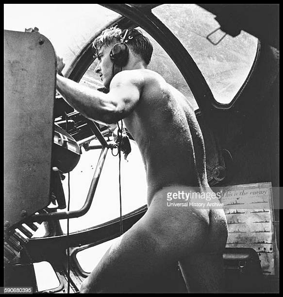 Photograph of a nude crewman of a US Navy rescue mission after jumping into the Harbor to rescue Marine pilots shot down while bombing Japanese fort...