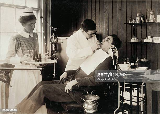 Photograph of a patient in a dentist's chair having dental work 1917 Silver print