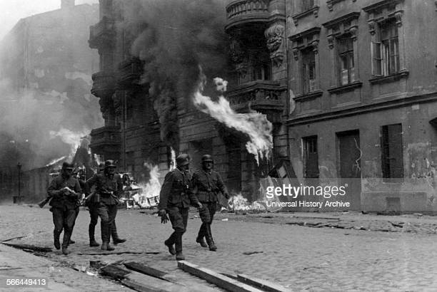 Photograph of a patrol of SS men on Nowolipie Street during the Warsaw Ghetto Uprising Dated 1943