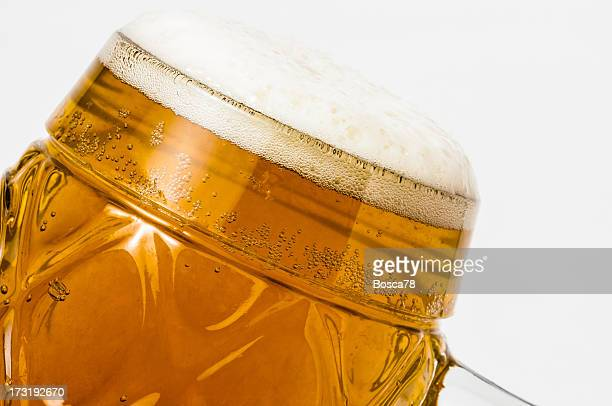 Photograph of a perfectly filled, foamy glass of beer.