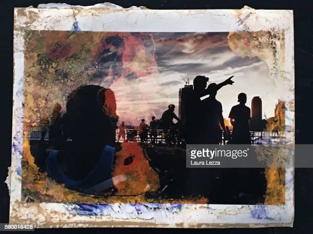 A photograph of a picture of the photographer Daniele Dainelli covered in mud hit by the flood of Livorno is displayed on October 8 2017 in Livorno...