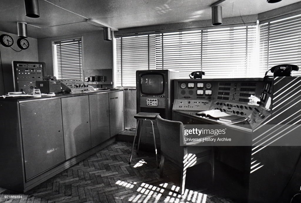Photograph of a radio telescope control room. A radio telescope is a specialised antenna and radio receiver used to receive radio waves from astronomical radio sources in the sky in radio astronomy. Dated 20th century.