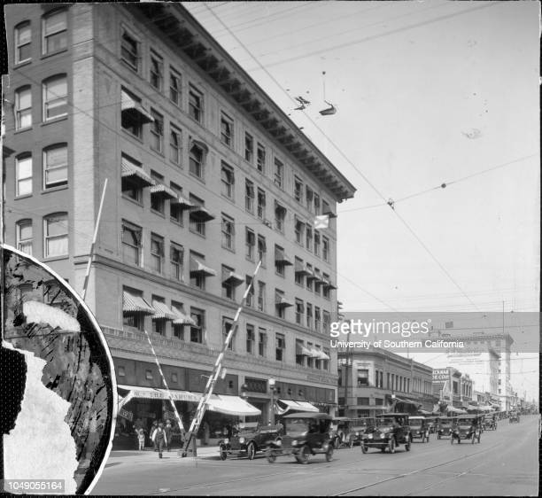 Photograph of a railroad crossing in front of the Security National Bank building 'Calif Pasadena Security Bank 12724' handwritten note on...