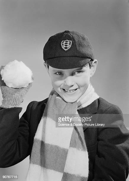A photograph of a schoolboy about to throw a fake snowball taken by Photographic Advertising Limited in about 1955 Photographic Advertising Limited...