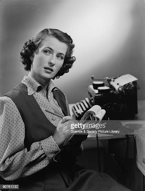 A photograph of a secretary making notes taken by Photographic Advertising Limited in 1951 Photographic Advertising Limited was founded in 1926 by a...