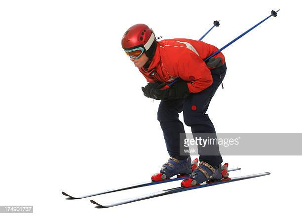 Photograph of a skier isolated on white background
