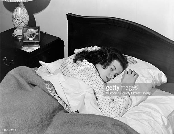 A photograph of a sleeping woman taken by Photographic Advertising Limited in 1952 The photograph was used in 1954 in a medical exhibition to...