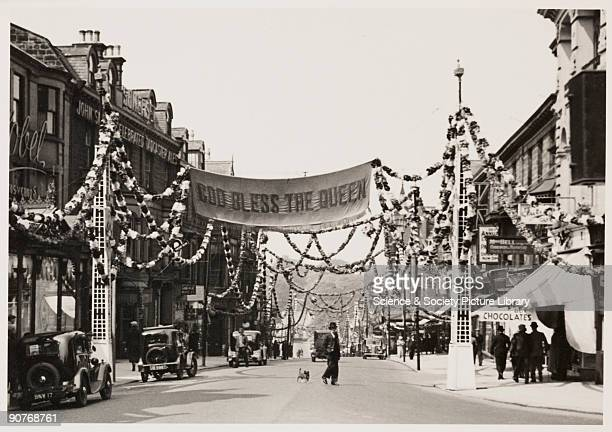 A photograph of a street in Harrogate Yorkshire taken by an unknown photographer in May 1937 The street has been decorated to celebrate the...