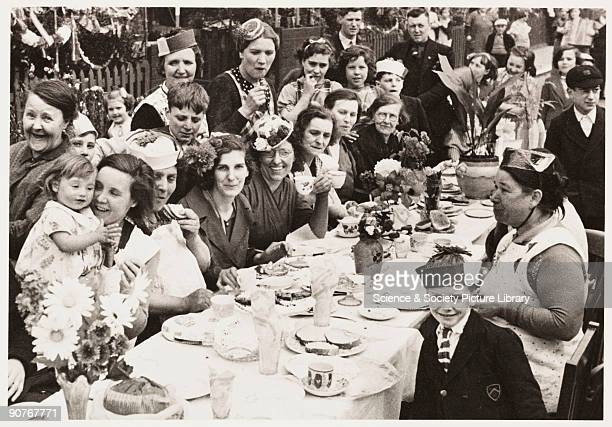 A photograph of a street party in Battersea London held to celebrate the Coronation of King George VI taken by an unknown photographer in May 1937...