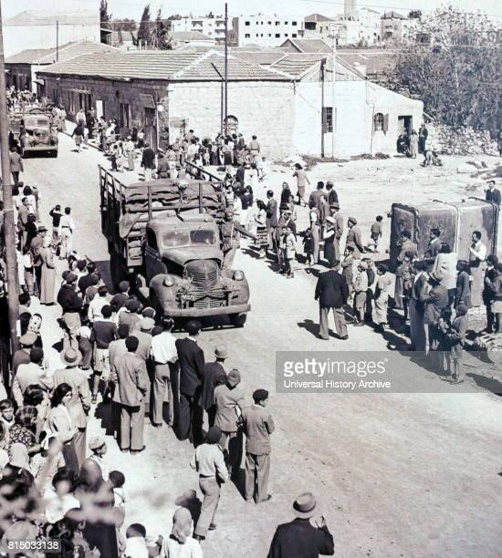 Photograph of a supply convoy arrives in Jerusalem After three weeks of blockade by Arab forces during the siege of Jerusalem during the Israeli War...