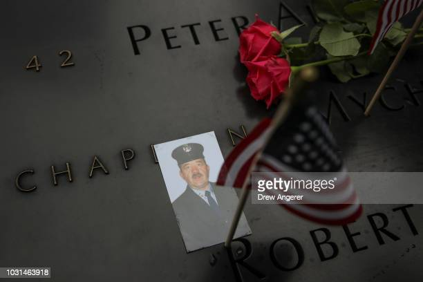 A photograph of a victim from the 9/11 terrorist attacks is left on the South Pool memorial during a commemoration ceremony for the victims of the...