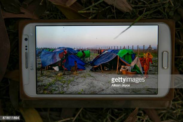 A photograph of a video that a Rohingya refugee took of Dongkhali camp on the banks of the Naf river in Myanmar on which an estimated 450 Rohingya...