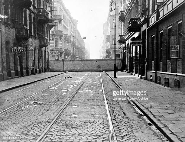 Photograph of a wall encircling Jewish ghetto in Warsaw, Poland. Dated 1943.
