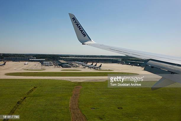 A photograph of a wing of a Ryanair plane approaching Stansted Airport in Essex England Stansted is a hub for a number of major European lowcost...
