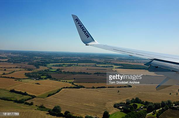 A photograph of a wing of a Ryanair plane flying over the English country side towards Stansted Airport in Essex England Ryanair was founded in 1985...