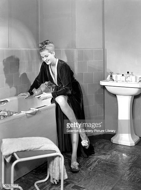 A photograph of a woman in a dressing gown running a bath taken by Photographic Advertising Limited in 1950 This image was used by the South Eastern...