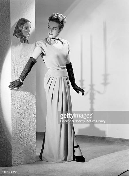 A photograph of a woman in an evening dress taken by Photographic Advertising Limited in 1950 Photographic Advertising Limited was founded in 1926 by...