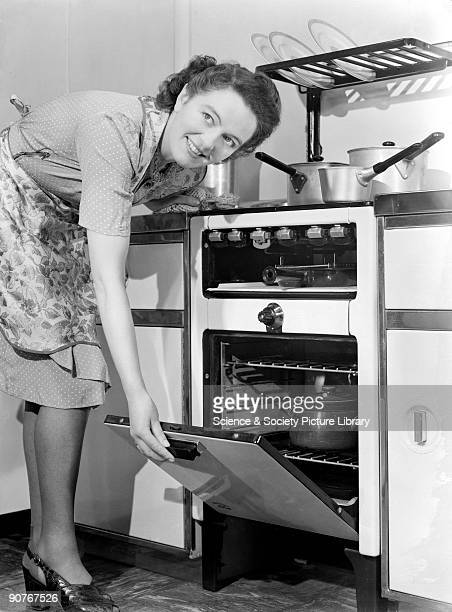A photograph of a woman opening the oven door to check on her cooking taken by Photographic Advertising Limited in the studio kitchen The company...
