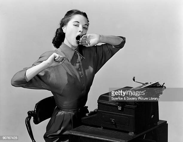 A photograph of a woman sitting yawning at a typewriter taken by Photographic Advertising Limited in 1950 Photographic Advertising Limited founded in...