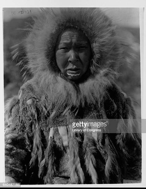 A photograph of a Yupik woman published in Volume XX of The North American Indian by Edward S Curtis | Location Nunivak Alaska Territory USA