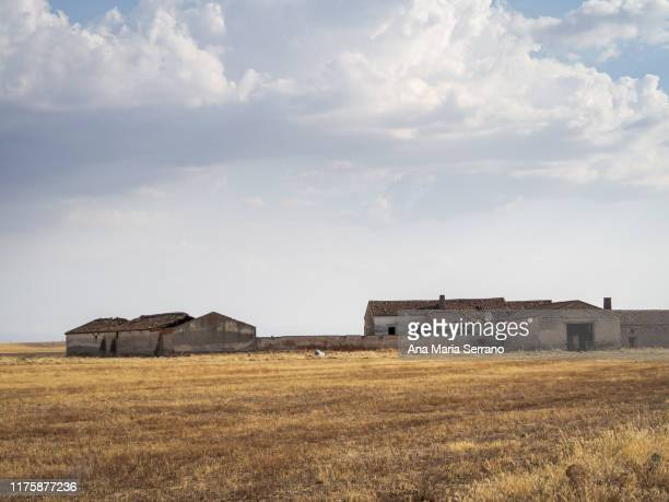 photograph  of abandoned houses, without doors or windows, ruined houses, collapsed roofs in an abandoned village called aldeayuste in salamanca, spain. rural depopulation concept - cidade pequena imagens e fotografias de stock