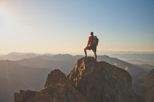 Photograph of adventurous backpacker standing on mountain peak, North Cascades National Park, Washington State, USA - gettyimageskorea