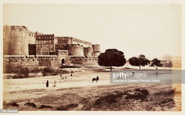 Photograph of Agra Fort, India, taken by Samuel Bourne. The fort is built along the Yamuna river and stretches for over a mile. Its outer wall was...